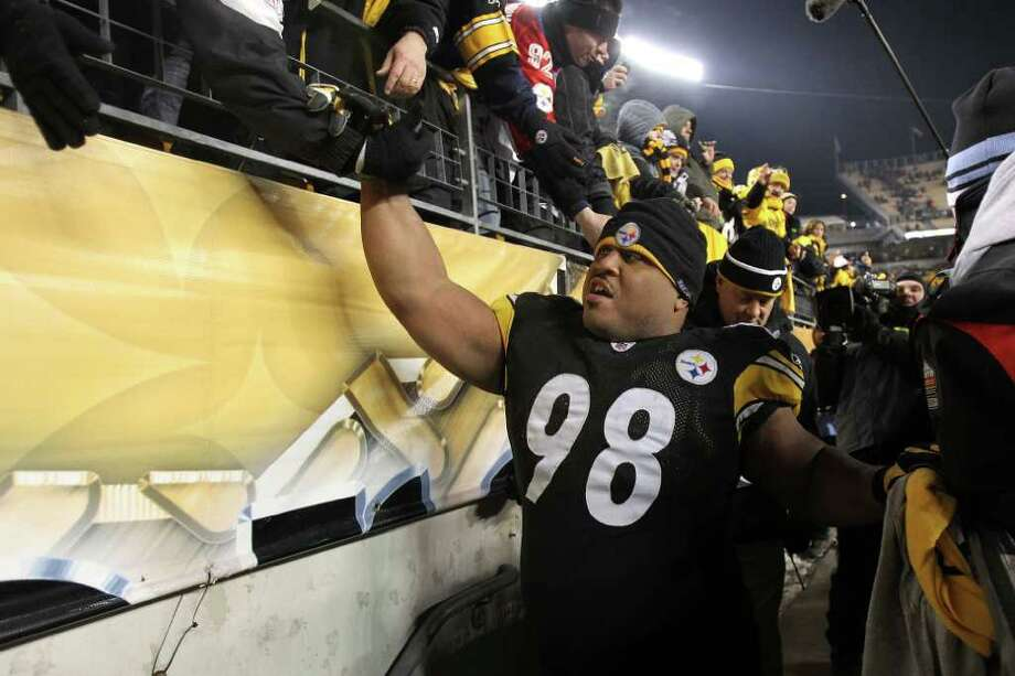 Pittsburgh Steelers nose tackle Casey Hampton celebrates with fans after their 24-19 win over the New York Jets last Sunday in the AFC championship game. Hampton is pursuing his third Super Bowl ring with the team. Photo: Ronald Martinez, Getty Images / 2011 Getty Images