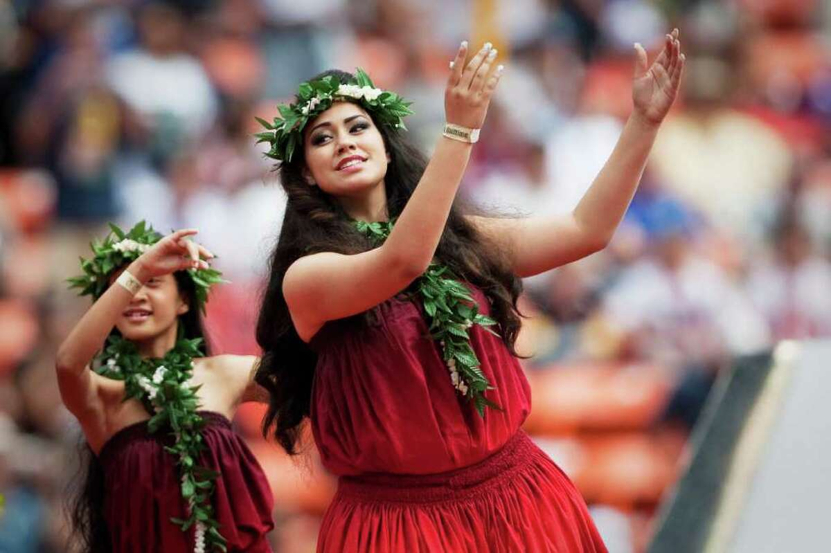 HONOLULU - JANUARY 30: Hula Dancers during the 2011 NFL Pro Bowl pre-game show at Aloha Stadium on January 30, 2011 in Honolulu, Hawaii. (Photo by Kent Nishimura/Getty Images)
