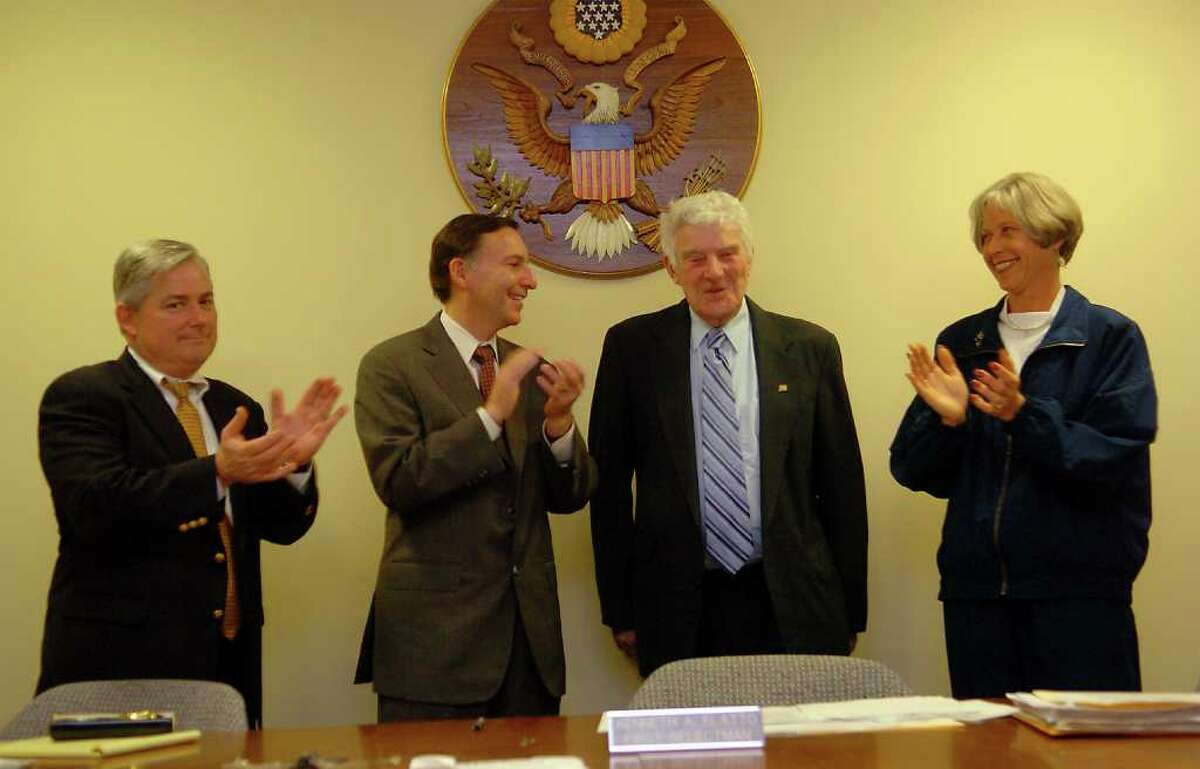 In a 2004 file photo, Fairfield Selectman Steve Elworthy (left), First Selectman Ken Flatto, and Selectman Denise Dougiello (right) clap their hands after awarding Carl Dickman with the Fairfielder of the Year award at the Sullivan-Independence Hall in Fairfield, Conn. Carl Dickman, a former Fairfield selectman and state legislator, whose career in public service spanned four decades, died Sunday Jan. 30, 2011. He was 84.