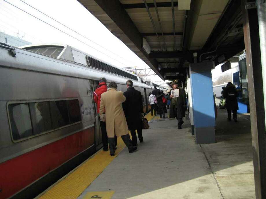 Greenwich commuters board a New York-bound train on the morning of Jan. 31, 2011. The harsh winter weather has left rail riders facing crowded cars and delays throughout January. Photo by Lisa Chamoff/staff Photo: Contributed Photo / Greenwich Time Contributed