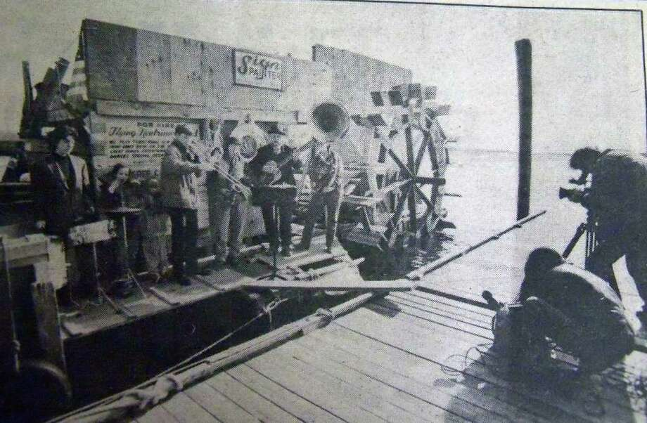 The Flying Neutrinos give a concert in February, 1991, at Southport Harbor after getting stuck in Fairfield when their boat died. They were given a March deadline by then First Selectman Jacquelyn Durrell to set sail. Photo: File Photo / Fairfield Citizen