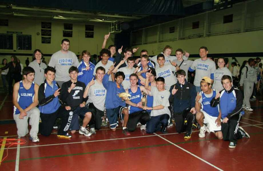 The Fairfield Ludlowe boys indoor track team celebrates its second consecutive FCIAC Central Division title, holding off second place Ridgefield on Saturday afternoon in Westport. The Falcons will try to turn their divisional crown into an FCIAC championship tomorrow in New Haven. Photo: Contributed Photo / Fairfield Citizen contributed