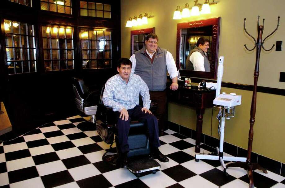 Partners Richard Ashikari and Jarrod Manfro in their shop Kennedy's All American Barber on High Ridge Rd in Stamford, Conn on Thursday January 20, 2011. Photo: Dru Nadler / Stamford Advocate Freelance