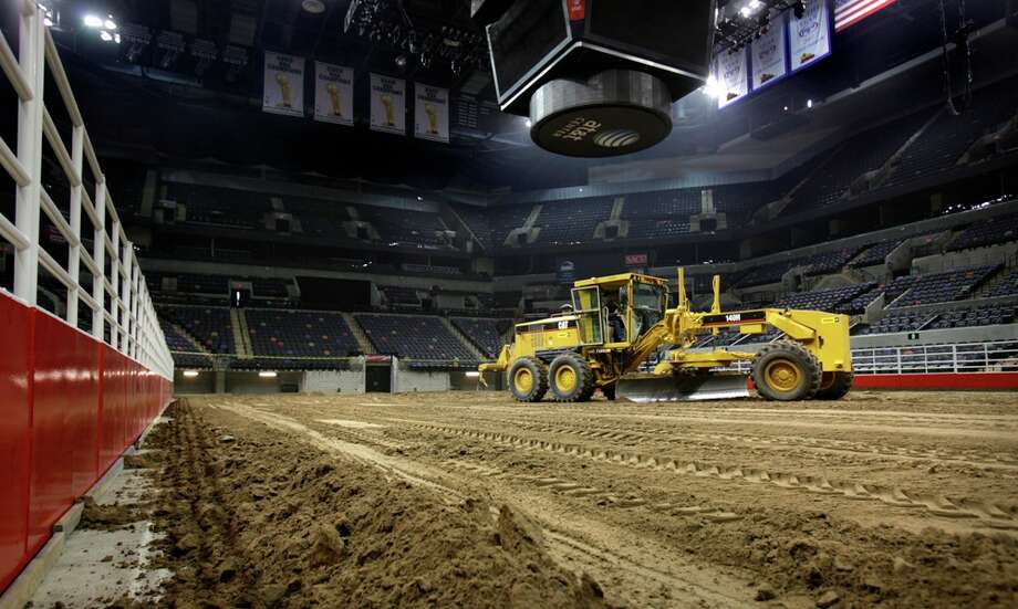 Workers dump and spread 2,160 tons of dirt in the ATT Center in preparation for the 2011 San Antonio Stock Show and Rodeo. Bob Owen/rowen@express-news.net