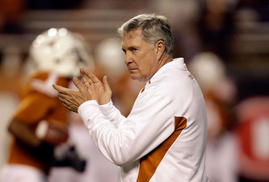 "Mack Brown, seen here at Nov. 13's game against Oklahoma State, said the Alabama loss ""felt like I had a hangover."" Photo: ERIC GAY, ASSOCIATED PRESS"