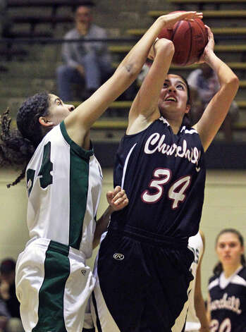 Reagan's Linda Kuster tries to stop Churchill's Danielle Espinoza during last week's 53-44 Reagan victory. Photo: TOM REEL, SAN ANTONIO EXPRESS-NEWS