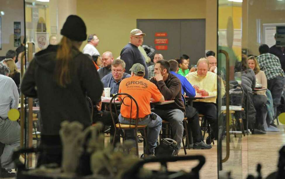 State workers eat in the main cafeteria in the Concourse during lunch hour at the Empire State Plaza in Albany, NY, on January 31, 2011. (Lori Van Buren / Times Union)