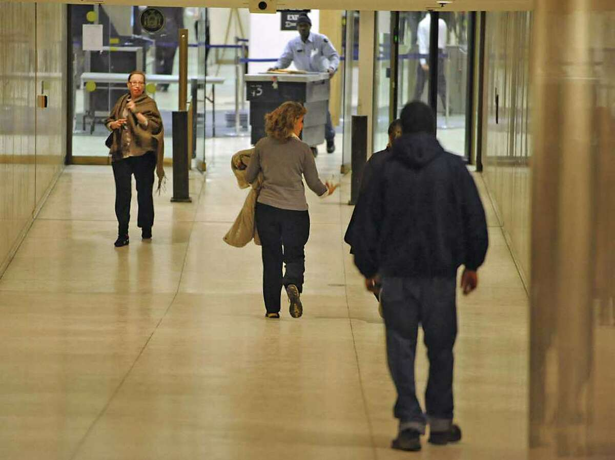 State workers walk in the Concourse during lunch hour at the Empire State Plaza in Albany, NY, on January 31, 2011. (Lori Van Buren / Times Union)