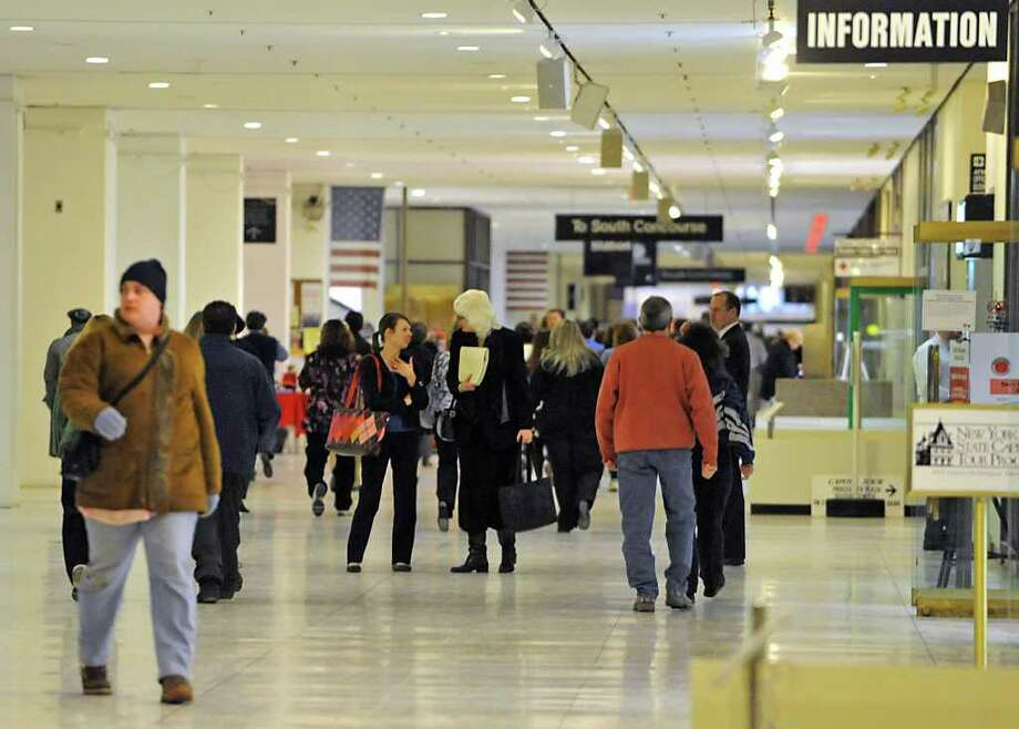 State workers walk in the Concourse during lunch hour at the Empire State Plaza in Albany, NY, on January 31, 2011. (Lori Van Buren / Times Union) Photo: Lori Van Buren