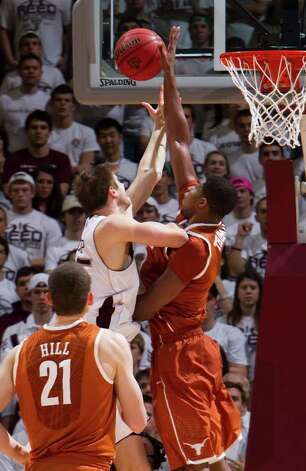 Texas' Tristan Thompson (right) blocks a shot by Texas A&M's Nathan Walkup (left) during the second half on Monday, Jan. 31, 2011, in College Station. Texas won 69-49. Photo: JON EILTS, ASSOCIATED PRESS