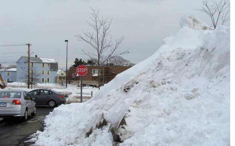 Towering piles of snow at intersections and parking lots throughout the region sharply curb drivers' lines of sight, posing a significant risk of accidents. Photo: Meg Barone / Fairfield Citizen freelance