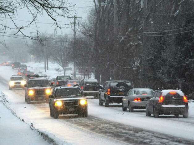 The snow from the first of two storms forecast for the area is already evident early Tuesday morning on Shaker Road in Loudonville. (Skip Dickstein / Times Union) Photo: SKIP DICKSTEIN / 2008
