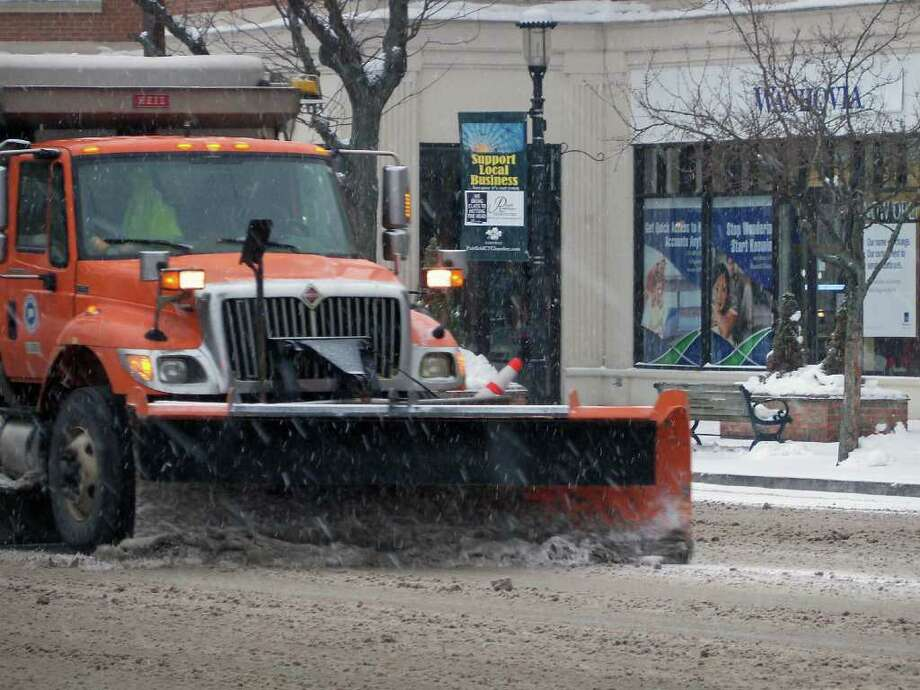 State plows clear snow, slush and ice from the Post Road Tuesday morning. Photo: Genevieve Reilly;Contributed Photo, Genevieve Reilly / Fairfield Citizen