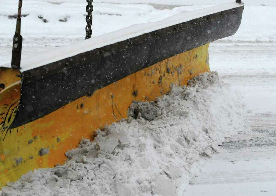 A plow moves the snow Tuesday from Washington Avenue  in Albany during the first of two snowstorms forecast to hit over the next two days.  (Skip Dickstein / Times Union) Photo: SKIP DICKSTEIN / 2008