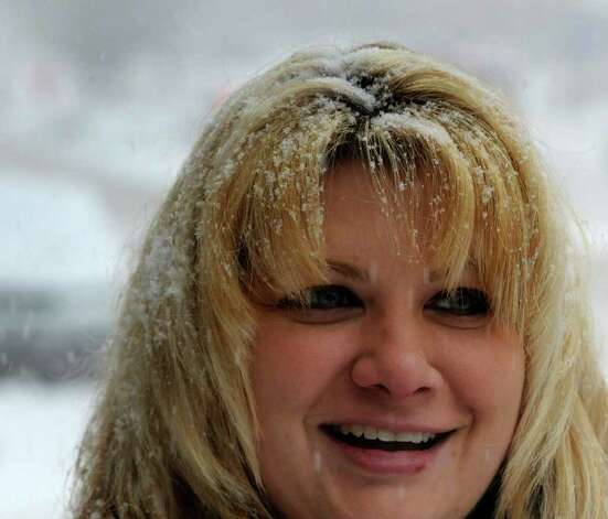Snow collects on Wendy Mueller's hair Tuesday as she clears the sidewalk on lower State Street in Albany. (Skip Dickstein / Times Union) Photo: SKIP DICKSTEIN / 2008