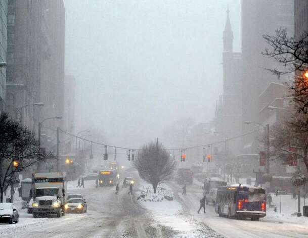 Tuesday's snowfall begins to obscure Lower State Street in Albany as the first of two snowstorms hits the Capital Region. (Skip Dickstein / Times Union) Photo: SKIP DICKSTEIN / 2008