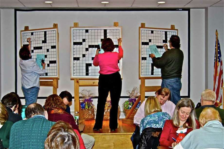 Pictured is some of the action from the 10th Annual Westport Public Library Crossword Puzzle Contest in 2009. The 12th annual event is taking place this Saturday at 1 p.m. Will Shortz, the New York Times crossword puzzle editor, has been involved from the beginning. Photo: Larry Untermeyer;Eliot Schickler, Larry Untermeyer  / Westport News