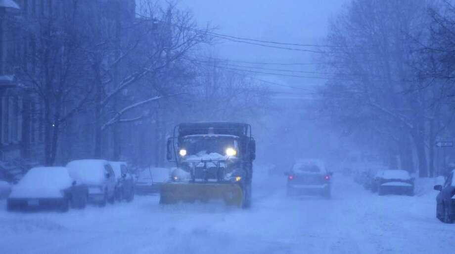 A city  plow on Tuesday clears snow from Ten Broeck Street in Albany. (Paul Buckowski / Times Union) Photo: Paul Buckowski / 00011944A