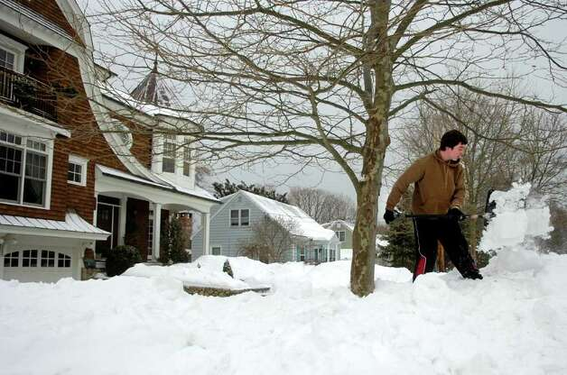 Martin Piekarski clears snow from large piles at the end of his driveway in Fairfield to help increase visibility when backing out of the driveway in Fairfield on Tuesday, February 2, 2011. Photo: Lindsay Niegelberg / Connecticut Post