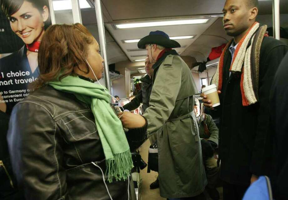 Commuters stand due to lack of seating on a train headed to Grand Central Station on Monday morning, Jan. 31, 2011. Photo: B.K. Angeletti / Connecticut Post