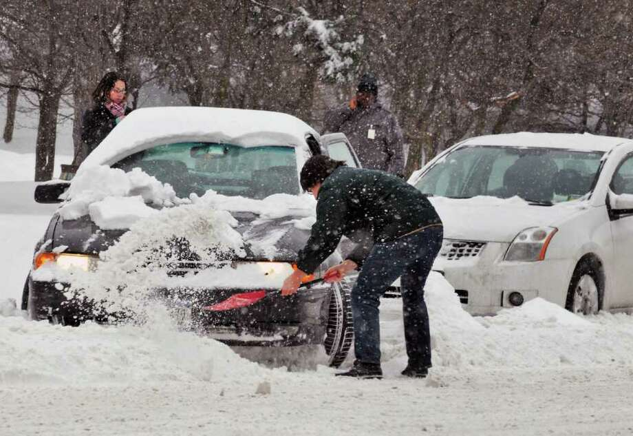 Brian Lemanski of Niskayuna digs out his car Tuesday on Madison Avenue in Albany.  (John Carl D'Annibale / Times Union) Photo: John Carl D'Annibale / 0202_weather