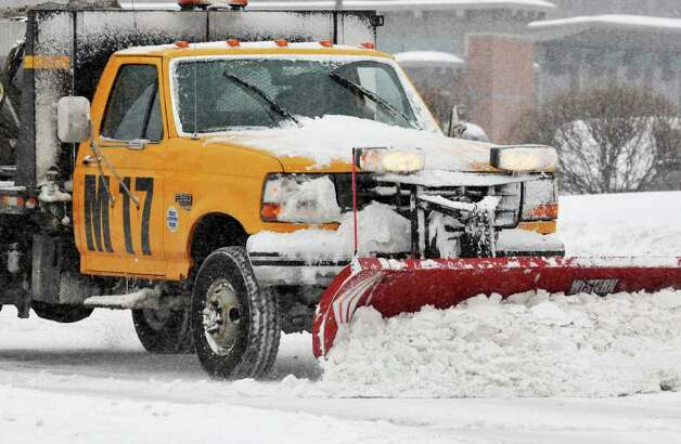A plow clears snow Tuesday morning at  Albany International Airport in Colonie.  (John Carl D'Annibale / Times Union) Photo: John Carl D'Annibale / 0202_weather