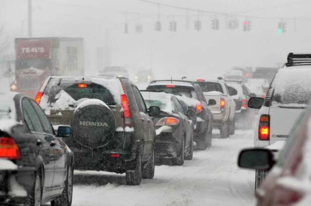 Southbound traffic Tuesday morning inches along Route 9 in Colonie.  (John Carl D'Annibale / Times Union) Photo: John Carl D'Annibale / 0202_weather