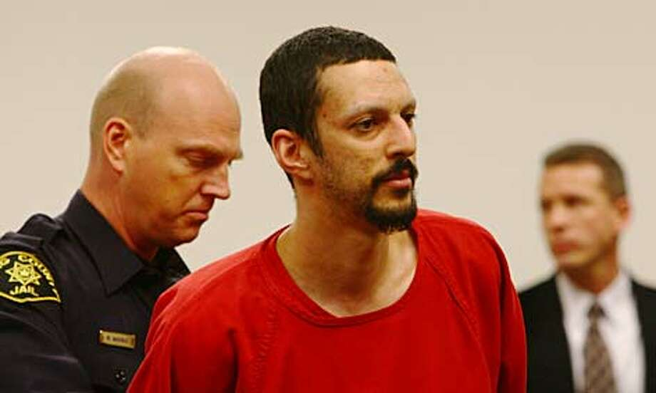 Daniel Hicks enters a King County courtroom Tuesday morning before pleading guilty in the murders of his girlfriend, Jennifer Morgan, and their 13-week-old daughter. Hicks faces a mandatory life sentence. Photo: Levi Pulkkinen/seattlepi.com