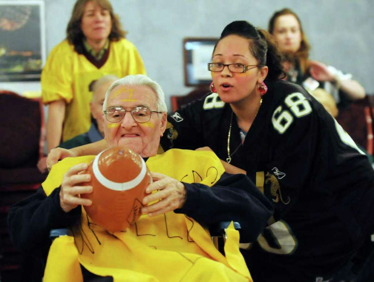 Activities coordinator Christie Bickley, right, assists resident Charles Salerno of the Wheelers team during their Wheelchair Super Bowl VIII against the Wheelers on Tuesday, Feb. 1, 2011, at the Teresian House in Albany, N.Y. (Cindy Schultz / Times Union)