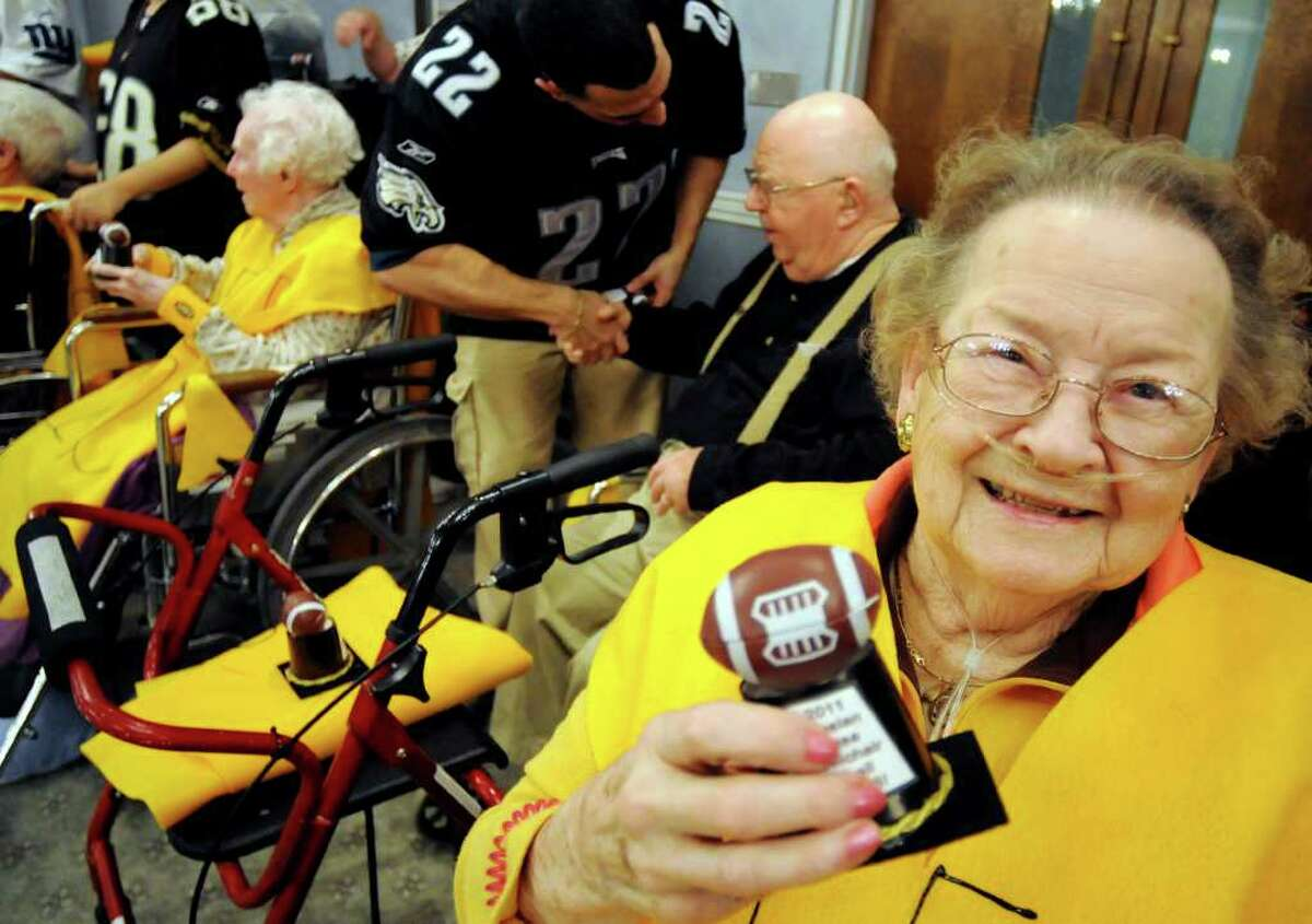 Resident Sophie Champagne of the Wheelers team holds up her trophy when her team beat the Sackers during Wheelchair Super Bowl VIII on Tuesday, Feb. 1, 2011, at the Teresian House in Albany, N.Y. (Cindy Schultz / Times Union)