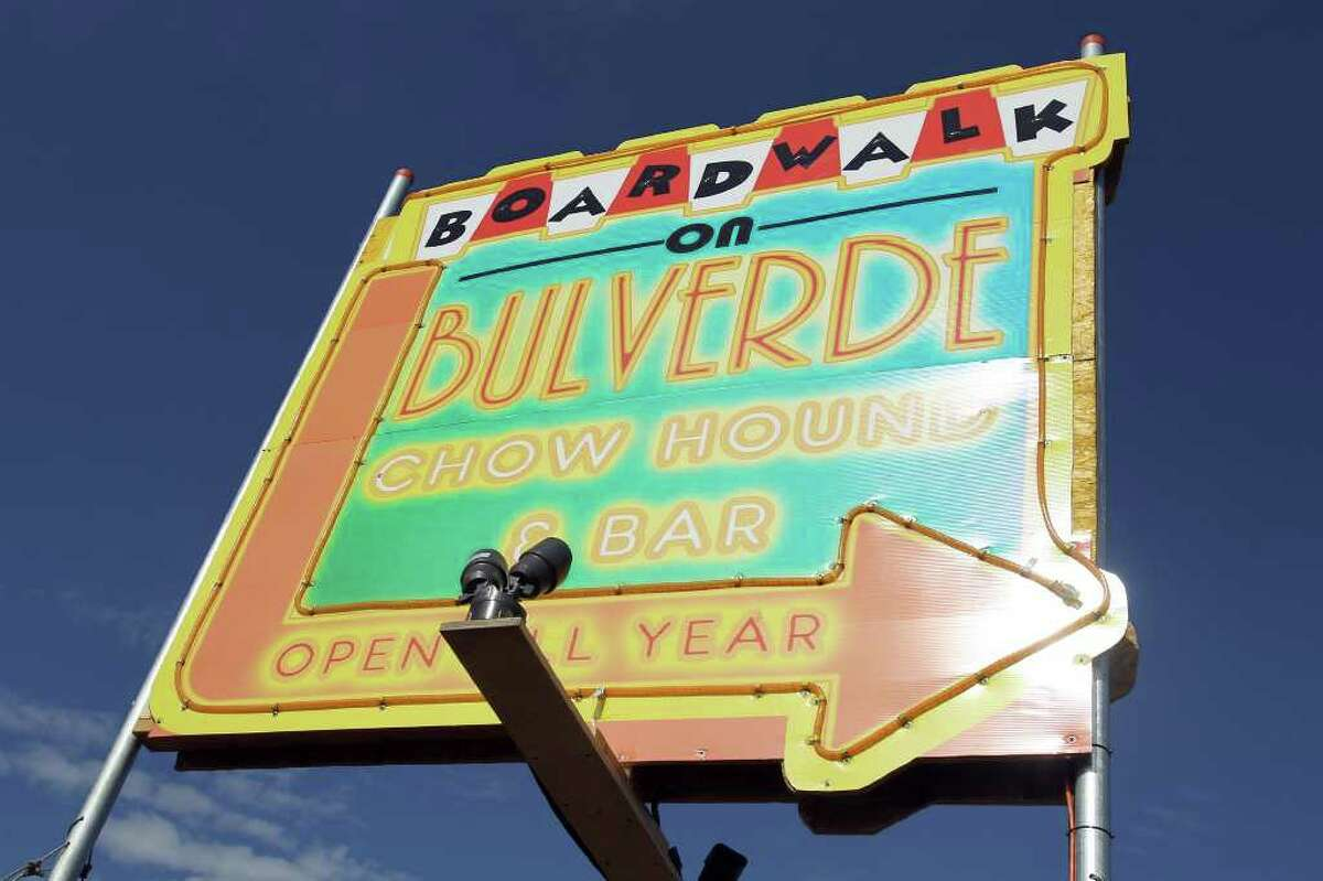 A brightly colored sign along Bulverde Rd. just south of 1604 lures hungry customers to the grand opening of Boardwalk on Bulverde, San Antonio's first mobile food truck park, Saturday, January 8, 2011.