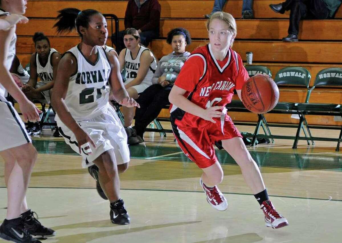 New Canaan's #10 Sarah Mannelly dribbles ahead of Norwalk #21 Alyssa Harris as Norwalk High School hosts New Canaan High School in Norwalk, CT on Monday January 10, 2011.