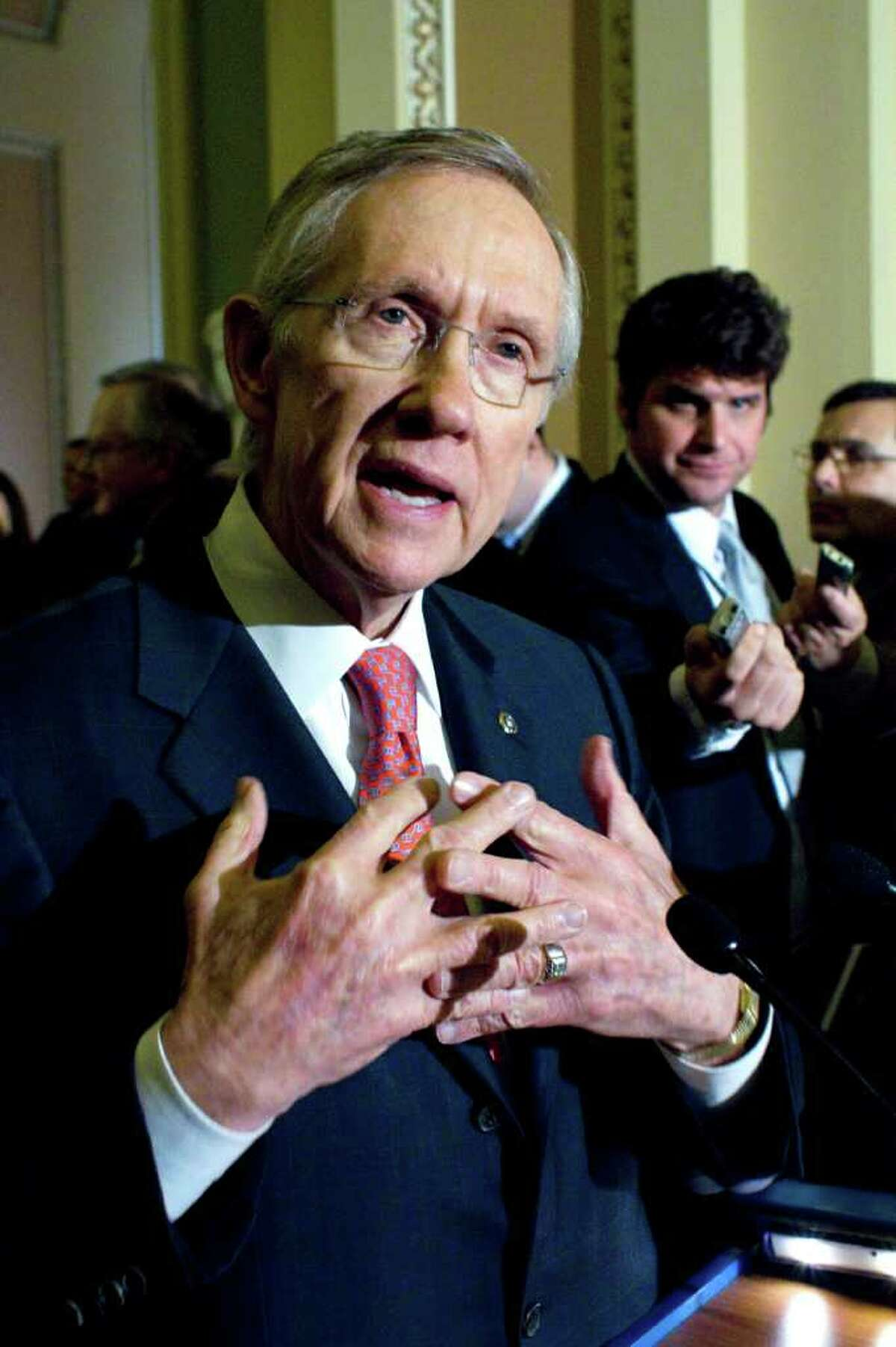 Senate Majority Leader Harry Reid, D-Nev., speaks to reporters after the weekly caucus luncheons on Capitol Hill in Washington, Jan. 25, 2011. (AP Photo/Harry Hamburg)