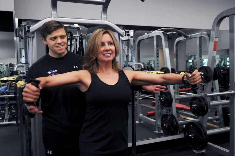 Personal trainer Matt Caron, of Trumble, watches PTP Fitness client Tina Feldman, of New Canaan, work out at PTP Fitness of Greenwich, Wednesday, Jan. 26, 2011. Photo: Helen Neafsey / Greenwich Time