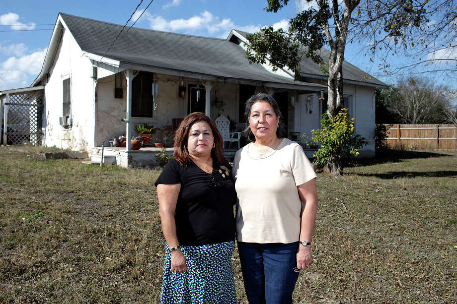 Cousins Teresa Bustillos Abrego (left) and Josephine Rodriguez Mendoza stand outside Mendoza's home. The family now owns just a fraction of the lands granted to it in 1848. Photo: EDWARD A. ORNELAS/eaornelas@express-news.net