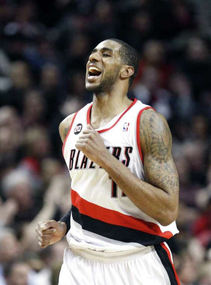 Portland Trail Blazers' LaMarcus Aldridge celebrates after scoring on the San Antonio Spurs in the second half during an NBA basketball game Tuesday, Feb. 01, 2011, in Portland, Ore. The Trail Blazers defeated the Spurs 99-86. Photo: AP