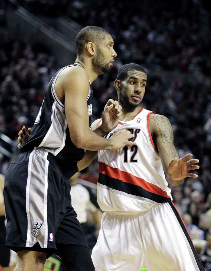 Portland Trail Blazers' LaMarcus Aldridge (12) defends against San Antonio Spurs' Tim Duncan in the second half during an NBA basketball game Tuesday, Feb.1, 2011, in Portland, Ore. The Trail Blazers defeated the Spurs 99-86. Photo: AP