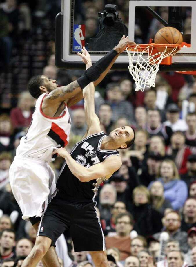 Portland Trail Blazers' LaMarcus Aldridge dunks the ball on San Antonio Spurs' Manu Ginobili (20) in the second half during an NBA basketball game Tuesday, Feb.1, 2011, in Portland, Ore. The Portland Trail Blazers defeated the Spurs 99-86. Photo: AP