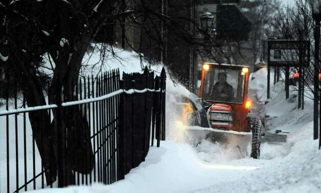Workers clear the sidewalk in Wednesday's predawn hours on Broadway in Saratoga Springs. (Skip Dickstein / Times Union) Photo: SKIP DICKSTEIN / 2008