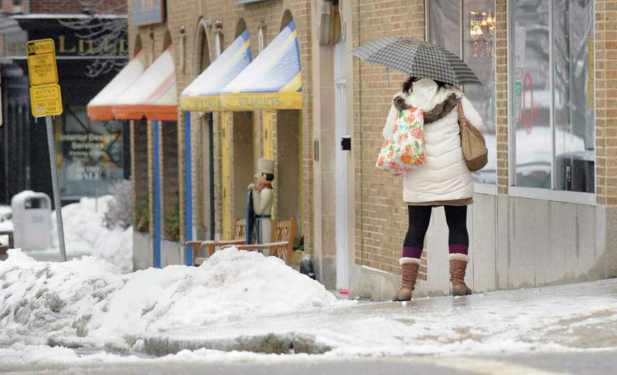 A woman slides down an icy sidewalk at the corner of Greenwich Avenue and West Elm Street, Greenwich, during the ice storm that hit the area, Wednesday morning, Feb. 2, 2011.