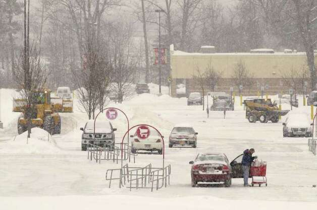 Crews use front-end loaders to clear the parking lot at the Target in Latham as a second winter storm hit the Capital Region Wednesday, Feb. 2, 2011.  (Paul Buckowski / Times Union) Photo: Paul Buckowski / 10011954A
