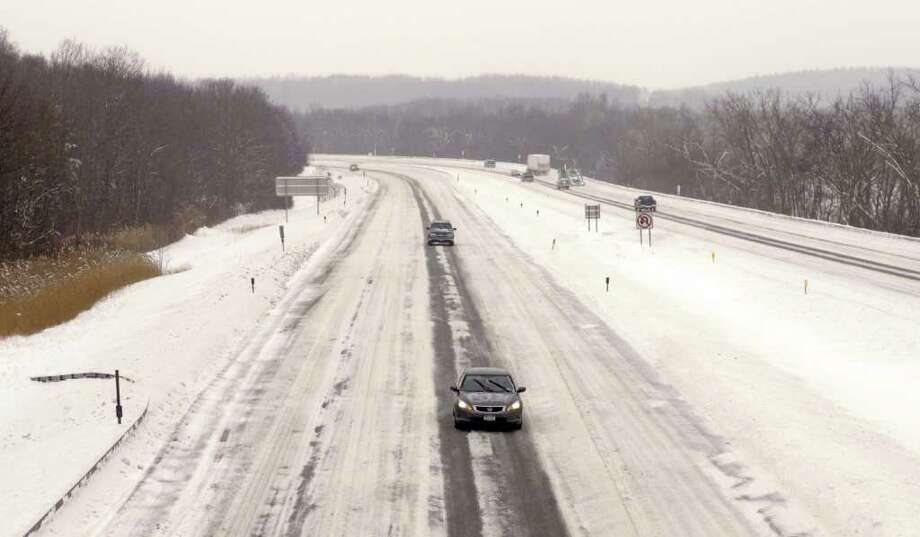 The northbound lanes on Interstate 87 is mostly desserted as motorists heeded the warnings to stay home.  (Paul Buckowski / Times Union) Photo: Paul Buckowski / 10011954A