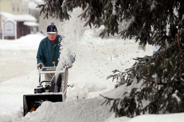 Patrick O'Connell clears his neighbor's walkway on Western Avenue following a snow storm on Wednesday, Feb. 2, 2011, in Albany. (Cindy Schultz / Times Union) Photo: Cindy Schultz