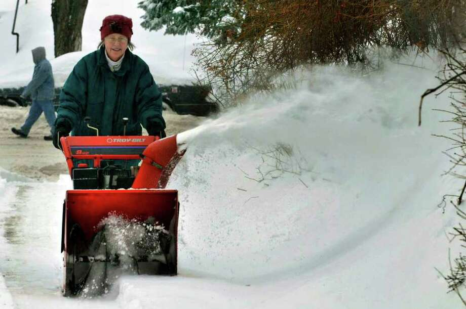 Pam Williams clears her driveway on South Allen Street in Albany on Wednesday, Feb. 2, 2011.( Michael P. Farrell/Times Union ) Photo: Michael P. Farrell