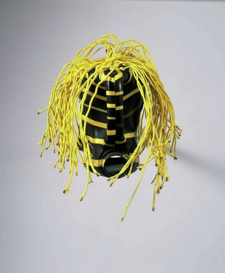 "Romuald Hazoum?s ""Claudia Maigre,"" 2005. Plastic can, synthetic and cotton thread. (Courtesy The Tang Museum)"