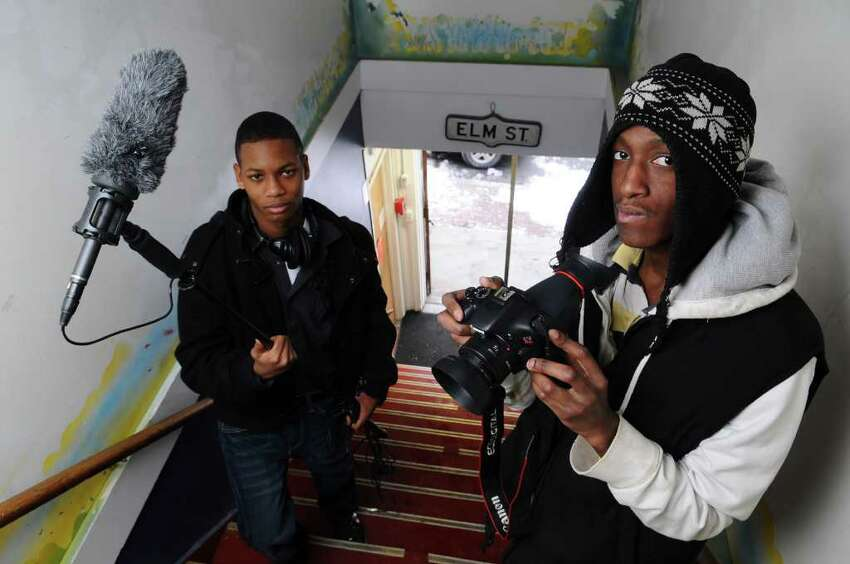 Albany High School senior Majestic Tillman, left, and Green Tech 10th-grader Rashid Howell, right, will show a film about the Latino youth conference, at the Youth FX film show on Thursday, shown here in Albany, NY on Sunday January 30, 2011. ( Philip Kamrass / Times Union )