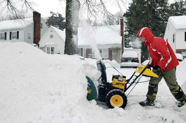Lee McPeters, 18, tackles a snow drift from a plow at the foot of his driveway following a snowstorm on Wednesday, Feb. 2, 2011, in Albany, N.Y. (Cindy Schultz / Times Union) Photo: Cindy Schultz
