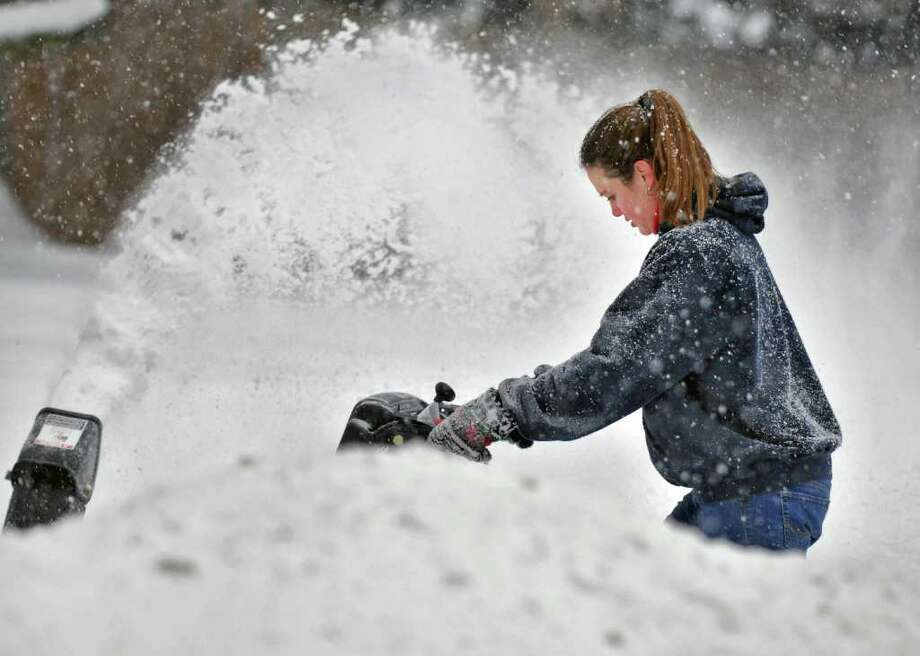 Bridget Pizzarelli users a snowblower to clear the driveway of her Clifton Park Home Wednesday February 2, 2011.   (John Carl D'Annibale / Times Union) Photo: John Carl D'Annibale / 10011954A