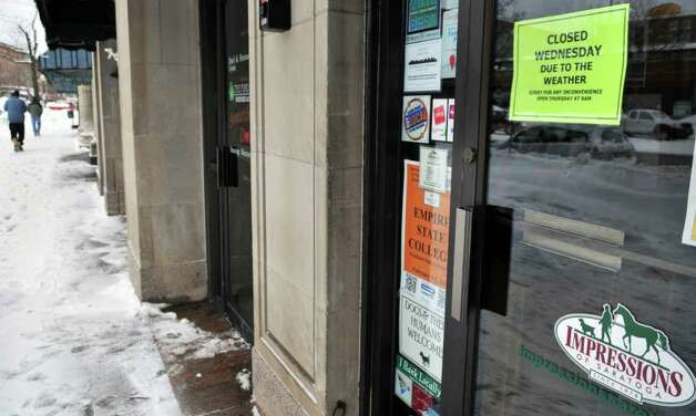 """Closed due to weather"" sign at the entrance to Impressions on Broadway in Saratoga Springs Wednesday February 2, 2011.   (John Carl D'Annibale / Times Union) Photo: John Carl D'Annibale / 10011954A"