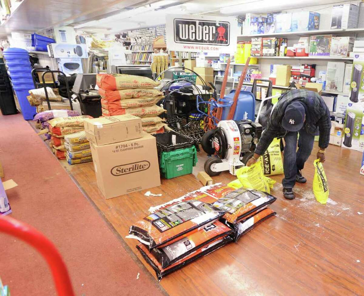 A patron of Greenwich Hardware store on Greenwich Avenue buys Ice-A-Way de-icing material, Wednesday afternoon, Feb. 2, 2011.